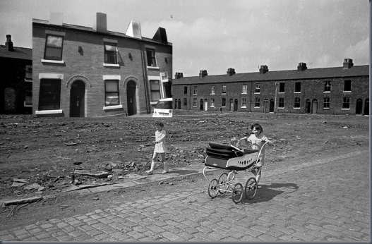 Young-girls-take-baby-sister-for-walk-Salford-1969